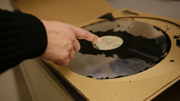 A 16-inch lacquer disc, a format used in the 1930s, from the collection of the Library of Congress. Most of the lacquer, the part of the disc where the sound was etched, has been lost to decay. (Library of Congress)