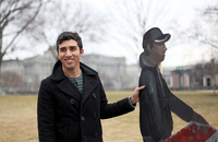 Los Angeles-based artist Ramiro Gomez Jr. displays his immigrant worker art on the Capitol's East Lawn in Washington, D.C.