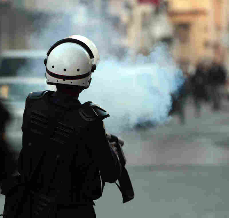 Riot police fire tear gas at anti-government protesters in Manama on Jan. 18.