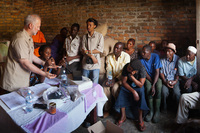 Shawn Askinosie, founder of Askinosie Chocolate, buys cocoa beans directly from farmers, like this Uwate cocoa farmers group in Tenende, Tanzania. Dealing direct
