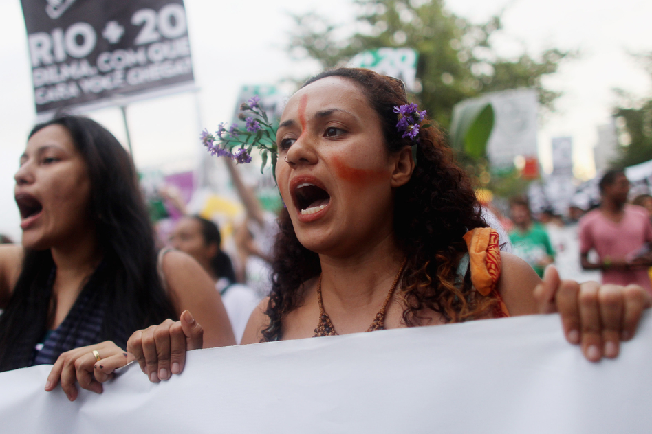 Protesters demonstrate against the Forest Code and Belo Monte dam project at the Rio+20 countersummit last June, in Rio de Janeiro. The summit aimed to overcome years of deadlock over environmental concerns. (Getty Images)