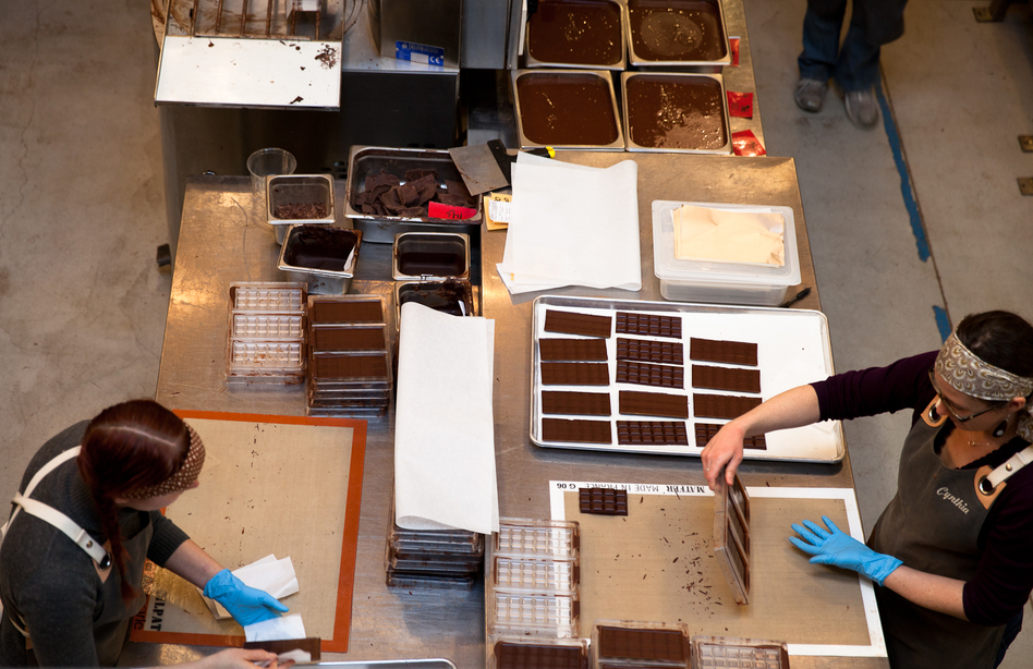 The Dandelion Chocolate factory has an open workspace where patrons can watch--and smell--the chocolate as it is ground, conched, formed into bars, and wrapped. (Molly DeCoudreaux)
