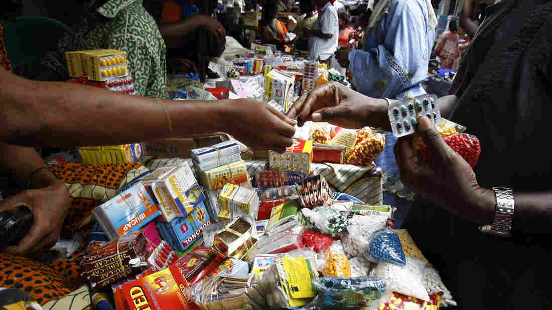 Shoppers buy smuggled counterfeit drugs at the Adjame market in Abidjan, Ivory Coast, in 2007.