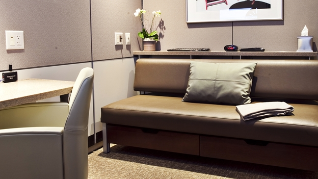 Minute Suite's 7-by-8-feet rooms offer Wi-Fi, a sofa bed, a television and a workspace. One traveler compared the small spaces to having an MRI done, but others say the idea is overdue at Chicago's O'Hare International Airport. (Courtesy of Minute Suites)