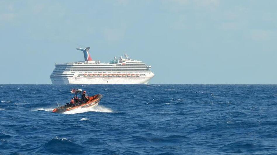 The Triumph cruise ship, set adrift in the Gulf of Mexico after an engine room fire Sunday, is being towed to Mobile, Alabama. The Carnival cruise ship line has cancelled the ship's next 14 voyages. (U.S. Coast Guard)
