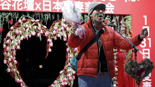 A man shouts his love at an event in Tokyo on Jan. 29. The event comes two days ahead of Beloved Wives Day, a day on which husbands publicly scream their love for their wives before a crowd of onlookers. Husbands are also urged to head home early to express gratitude to their wives. (EPA /Landov)