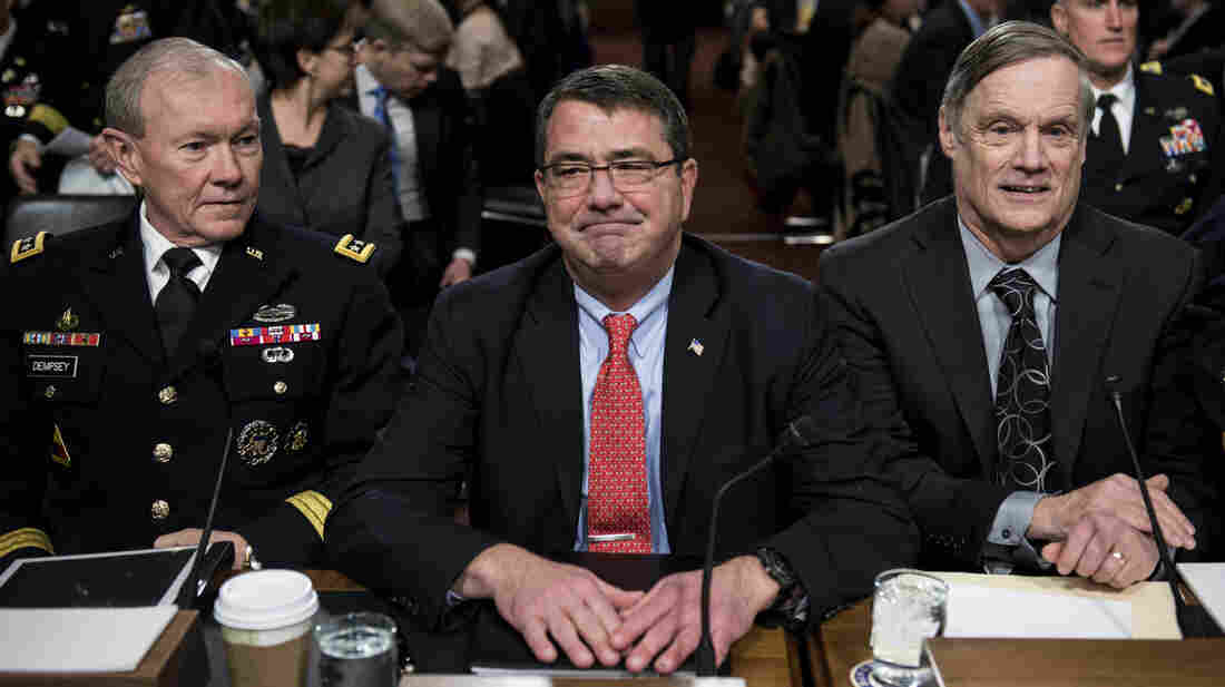 Joint Chiefs of Staff Chairman Martin Dempsey (from left), Deputy Secretary of Defense Ashton Carter and Undersecretary of Defense and Comptroller Robert Hale wait for a hearing of the Senate Armed Services Committee on Tuesday. Military leaders are warning Congress about the effects of the sequester.