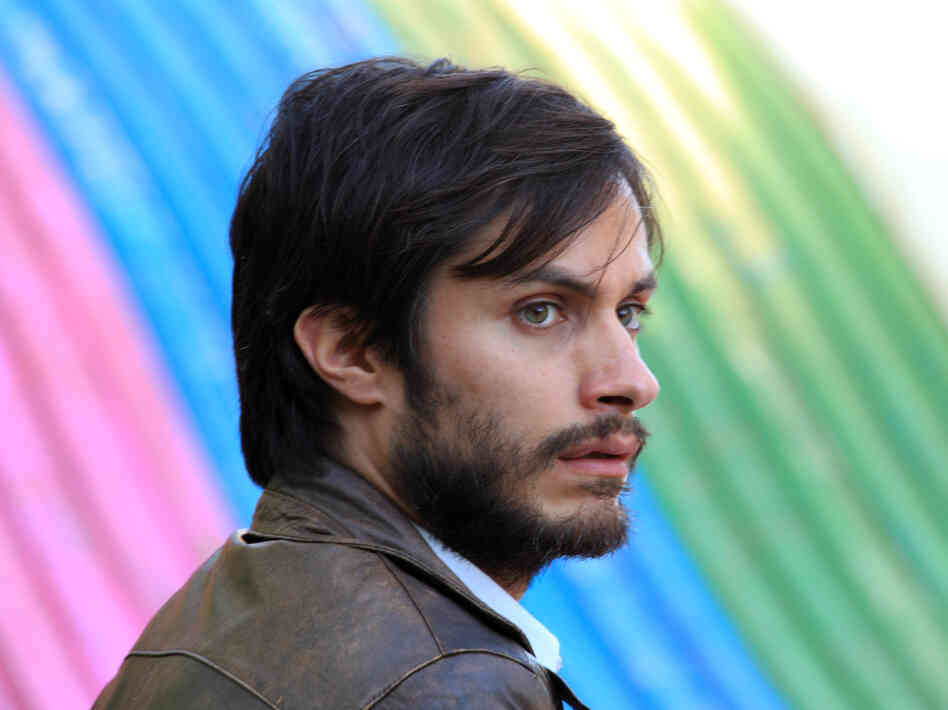 The bright colors and throwback feel of the Chilean drama No mask the very real political consequences of the 1988 plebiscite it depicts. (Pictured: Gael Garcia Bernal as Rene Saavedra)