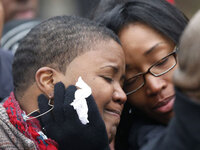 Cleopatra Pendleton (left) is consoled by her sister Kimiko Pettis on Jan. 30.