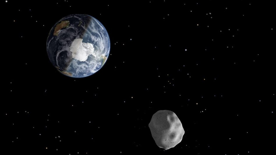 An illustration of what asteroid 2012 DA 14 may look like as it approaches Earth. (EPA /LANDOV)