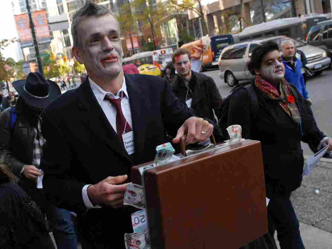 "Canadian zombies dress for success. (An Occupy Vancouver ""Zombie Walk"" in October 2011.)"