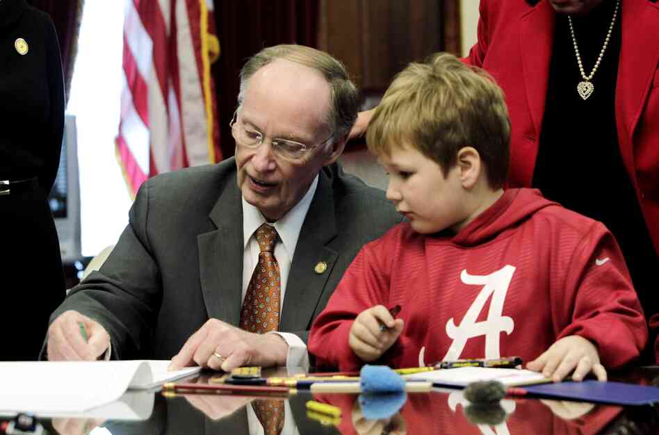 Ala. Gov. Robert Bentley colors with 6-year-old Ethan in a visit to the governor's office on Wednesday, Feb. 13, 2013.