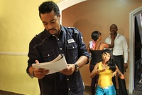 Actor Majid Michel on the set of the Nollywood film <em>Brother's Keeper</em> with co-star Belinda Effah.