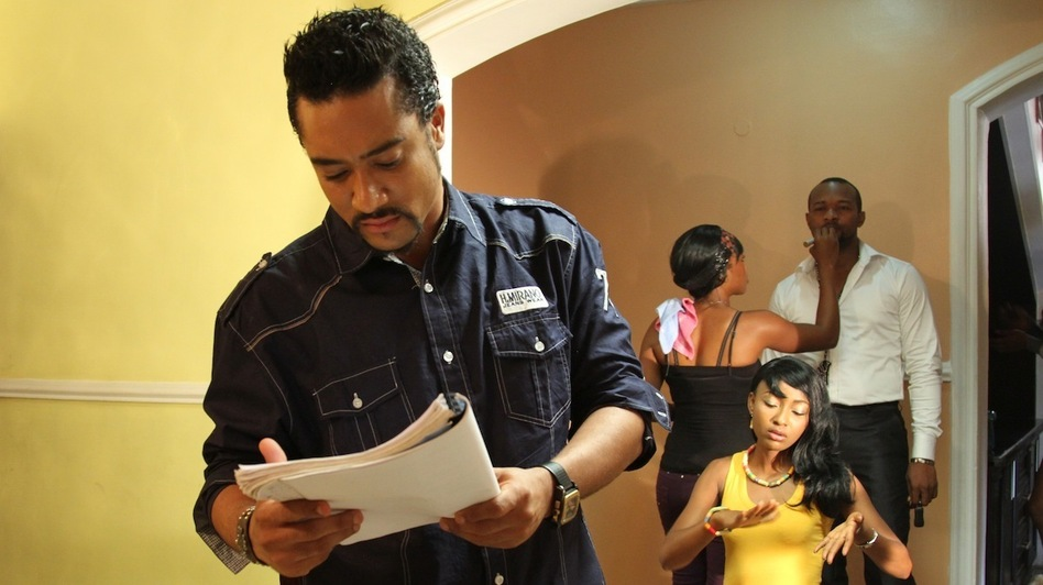 Actor Majid Michel on the set of the Nollywood film Brother's Keeper with co-star Belinda Effah. ( )