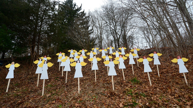 Wooden angels memorialize the victims of Adam Lanza's shooting spree in Newtown, Conn., last December. An upcoming Frontline documentary seeks to provide new details about Lanza and his mother, Nancy. (AFP/Getty Images)