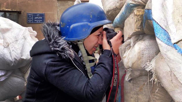Nour Kelze, a 25-year-old from Aleppo, Syria, was teaching English at a private school when the uprising started two years ago. Since then, she has learned to be a war photographer and has been sending photos to the Reuters news agency. (Courtesy of Nour Kelze)
