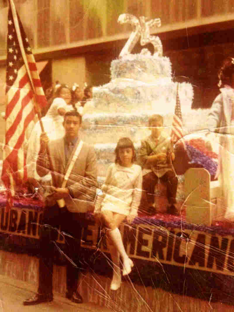George Prendes (left), with siblings Mercedes and Roberto at a Cuban-American parade in New York in the early 1970s. The family spent their savings trying to assist George after his arrest.