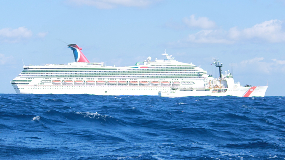 The Carnival cruise ship Triumph drifts in the Gulf of Mexico Monday, before the arrival of tugs that are now towing it to Mobile. The ship is expected to arrive Thursday night. (U.S. Coast Guard)
