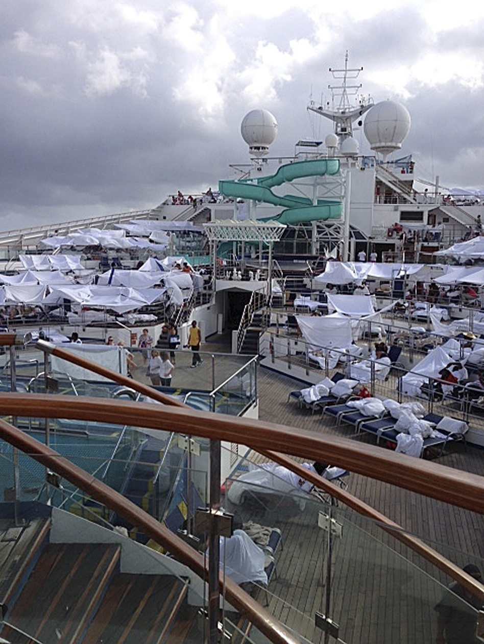 Makeshift tents are seen on the deck of the Carnival cruise ship Triumph, in a photo taken Sunday, the first day it spent without engine power. The image was provided by Kalin Hill of Houston. (Kalin Hill/AP)