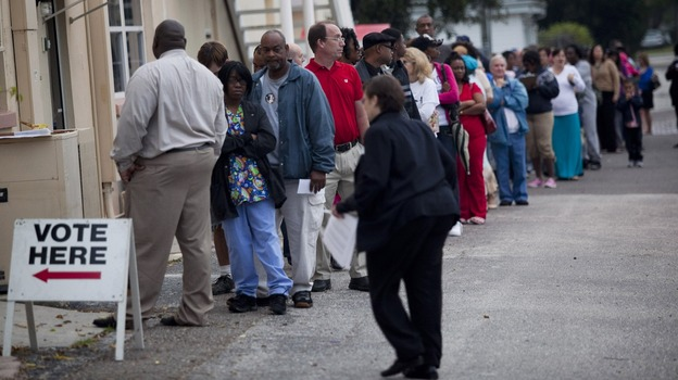 Lines of voters wait to cast their ballots as the polls open in St. Petersburg, Fla., on Nov. 6. (Getty Images)