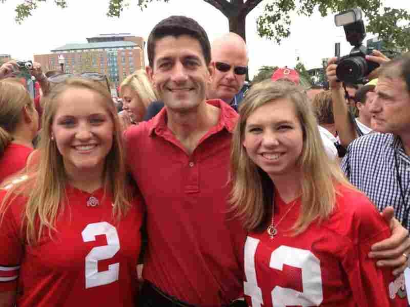 Ohio State University College Republicans Erin Miller (left) and Maggie Rochon (right) pose with former vice presidential candidate Paul Ryan before a game against Miami in September.