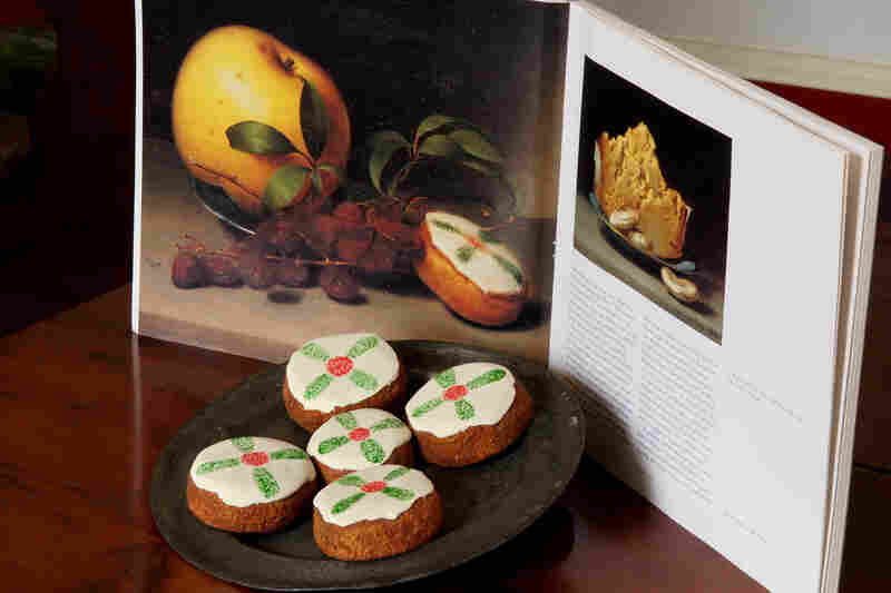 Cakes displayed with a reproduction of Raphaelle Peale's Still Life with Cake, from circa 1822.
