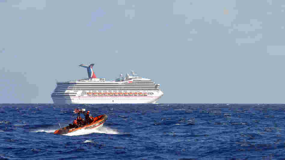 Coast Guard patrols near the cruise ship Carnival Triumph in the Gulf of Mexico on Monday. The Carnival Triumph lost propulsion power after an engine room fire a day earlier.