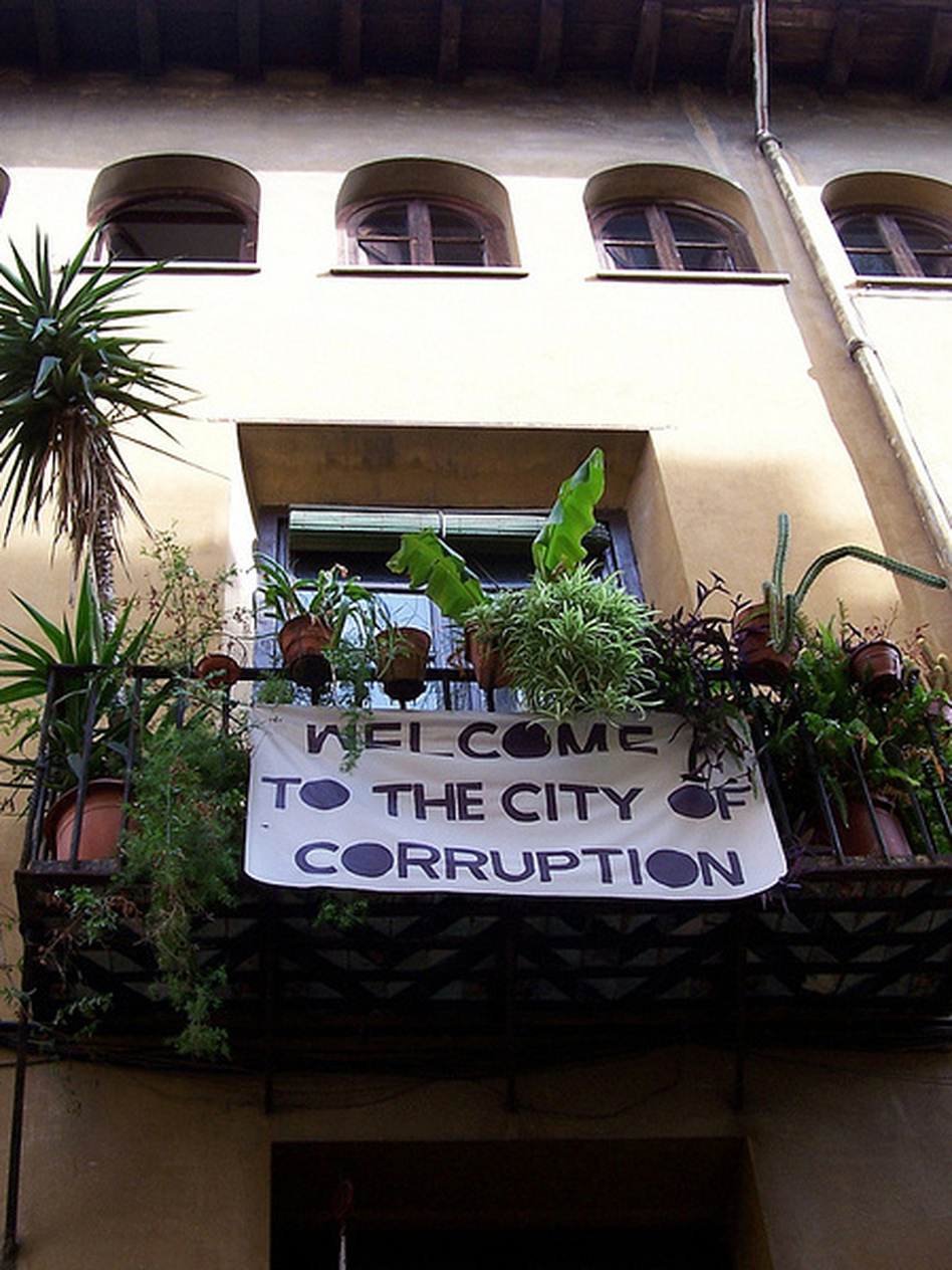 A protest banner in Valencia, Spain, reflects the view that the city's economic woes are a result of political corruption.