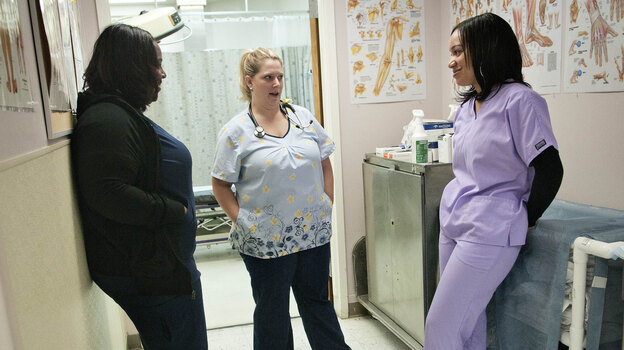 Peggy Renzi (middle) talks with her teammates Erika Hersey (left) and Erica Webster. The three are part of a team of nurses in the Bowie Health Center emergency room in Bowie, Md., who are working together to lose weight. (NPR)