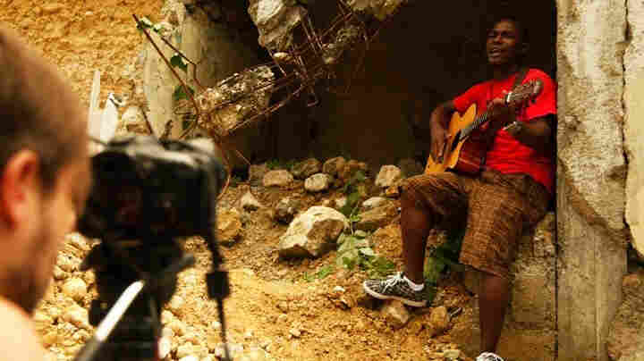 "Singer-songwriter Amos Dolce on the set of the video for his song ""Haiti, Haiti,"" which Konbit Mizik produced."