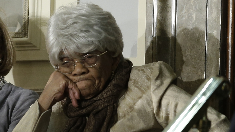 Desiline Victor, 102, of North Miami, awaits the start of President Obama's State of the Union address, which she attended Tuesday in the U.S. Capitol. The president spoke about Victor's long wait to vote last year. (AP)