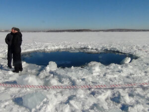 A hole in the ice of Chebarkul Lake where a meteor reportedly struck the lake near Chelyabinsk, about 930 miles east of Moscow