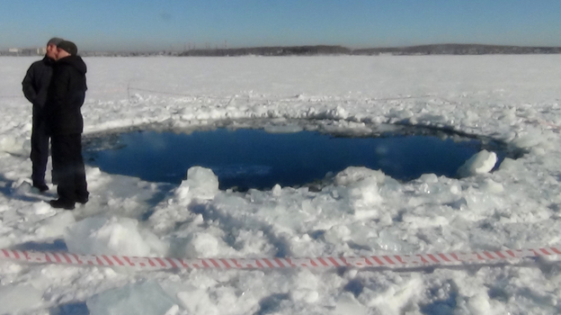 A hole in the ice of Chebarkul Lake where a meteor reportedly struck the lake near Chelyabinsk, about 930 miles east of Moscow (AP)