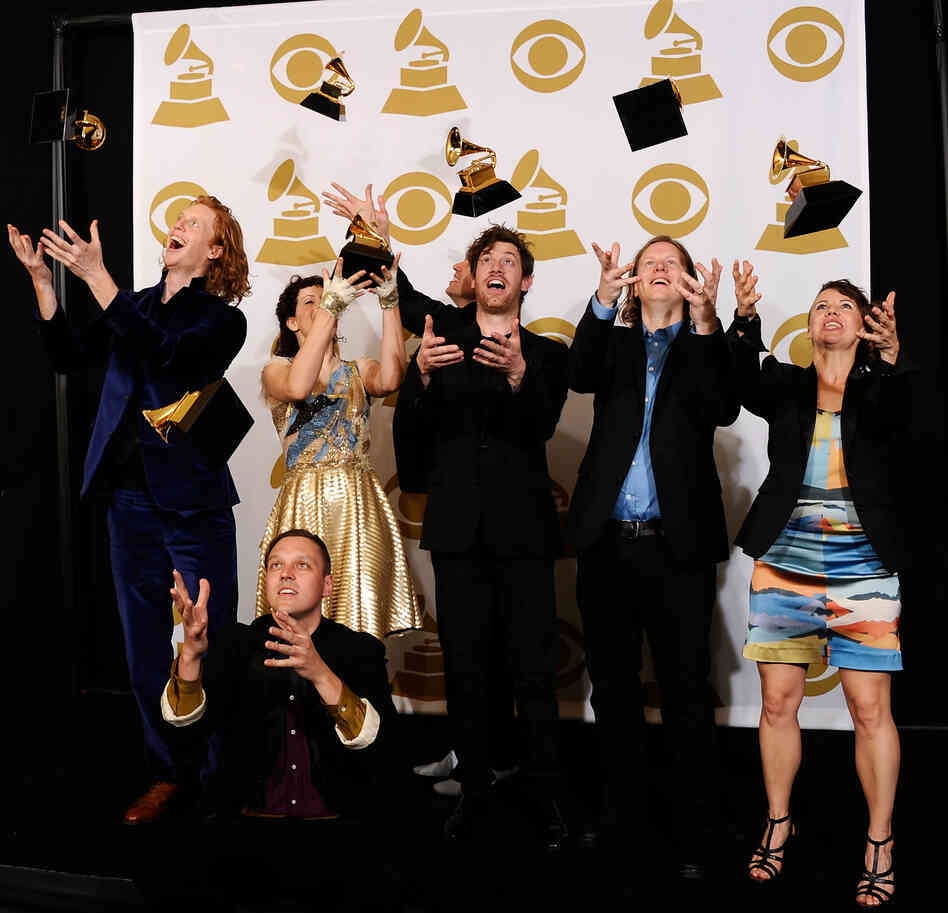 Arcade Fire's members with their album of the year Grammys.