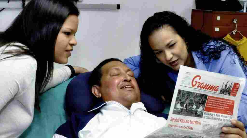 A handout picture made available Friday by the Venezuelan Ministry of Communications and Information shows Venezuelan President Hugo Chavez and his daughters  Rosa Virginia (right) and Maria Gabriela reading an edition of Cuban daily Granma, as he recovers from cancer surgery. It was reportedly taken on Thursday.
