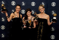 The members of The Dixie Chicks, (from left) Emily Robinson, Natalie Maines and Martie Maguire pose with their Grammys for Record of the Year, Album of the Year, Song of the Year, Best Country Performance by a Duo or Group with Vocal and Best Country Album.