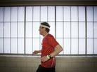 Don Wright runs at an indoor track at the Maplewood Community Center in North Saint Paul, Minn.