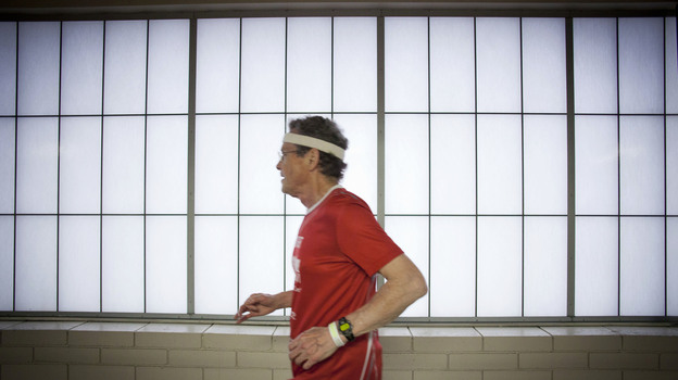 Don Wright runs at an indoor track at the Maplewood Community Center in North Saint Paul, Minn. (Ariana Lindquist for NPR)