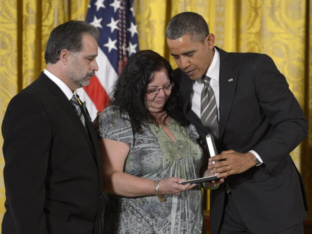 President Obama with Donna and Carlos Soto, who accepted the Presidential Citizens Medal awarded to their daughter, slain Sandy Hook teacher Victoria Soto.