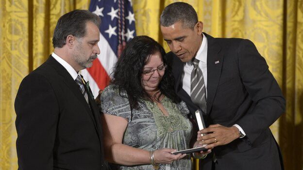 President Obama with Donna and Carlos Soto, who accepted the Presidential Citizens Medal awarded to their daughter, slain Sandy Hook teacher Victoria Soto. (EPA /LANDOV)