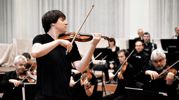 Violinist Joshua Bell conducts the Academy of St. Martin in the Fields by doing what comes naturally to him. The celebrated soloist is also the London orchestra's music director. (Sony Classical)