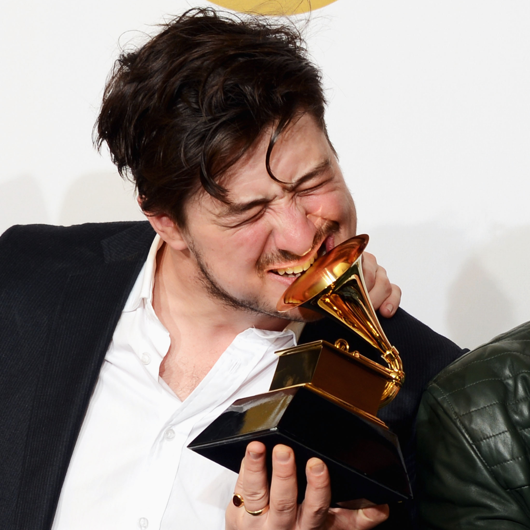 Marcus Mumford of Mumford & Sons, winner of Album of the Year at the 2013 Grammy Awards. To date, the band's winning album, Babel, has sold 1,737,000 copies, according to Nielsen Soundscan.