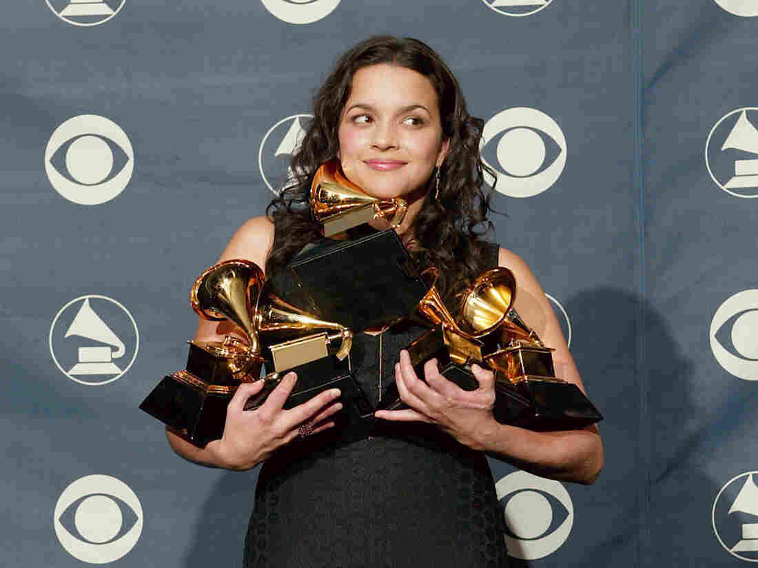 Norah Jones poses with her five Grammy Awards for Best Pop Vocal Album, Best Female Pop Vocal Performance, Album of the Year, Record of the Year and Best New Artist at the 45th Annual Grammy Awards.