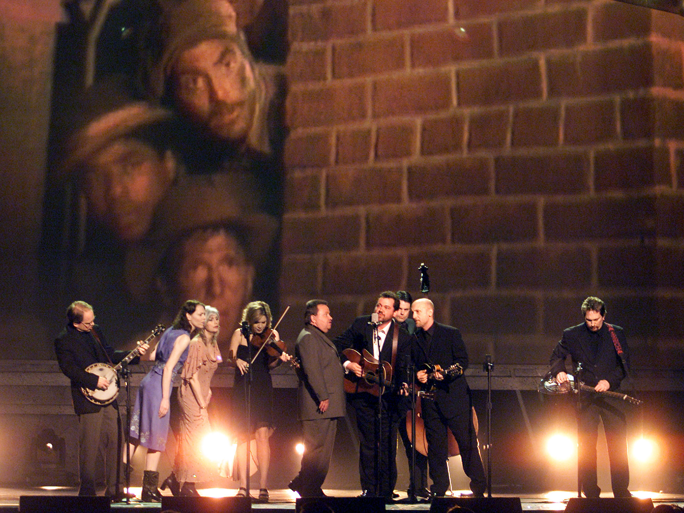 Gillan Welch (left), Emmylou Harris (center), and Alison Krauss with The Soggy Bottom Boys perform songs from the O Brother Where Art Thou? soundtrack at the 44th Annual Grammy Awards.