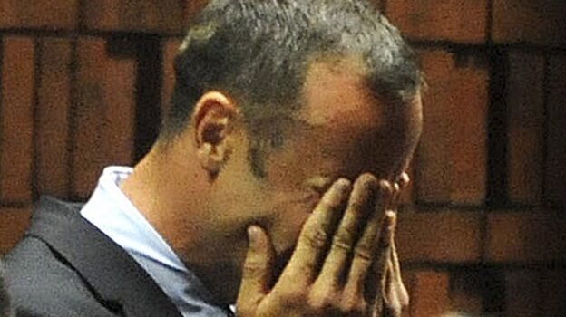 South African Paralympic and Olympic sprinter Oscar Pistorius as he wept today while being charged with murder. (EPA /LANDOV)