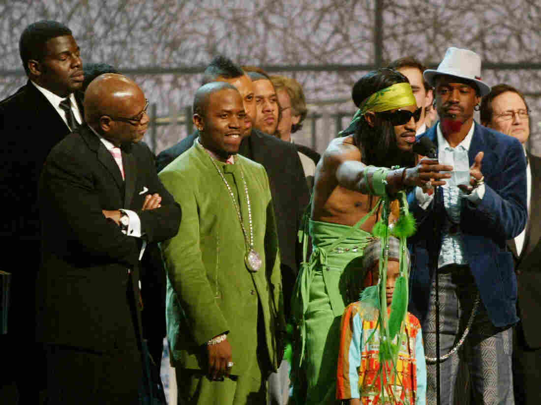 Andre 3000 (at microphone) and Big Boi of OutKast accept the Grammy for Album of the Year at the 46th Annual Grammy Awards.