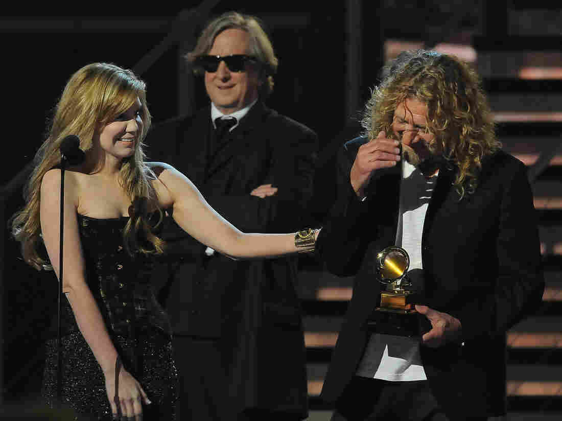 Alison Krauss (left) and Robert Plant (right) with producer T Bone Burnett accept the Album of the Year award at the 51st Grammy Award ceremony in 2009.
