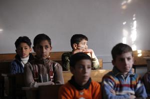 Children attend school in Aleppo in November.