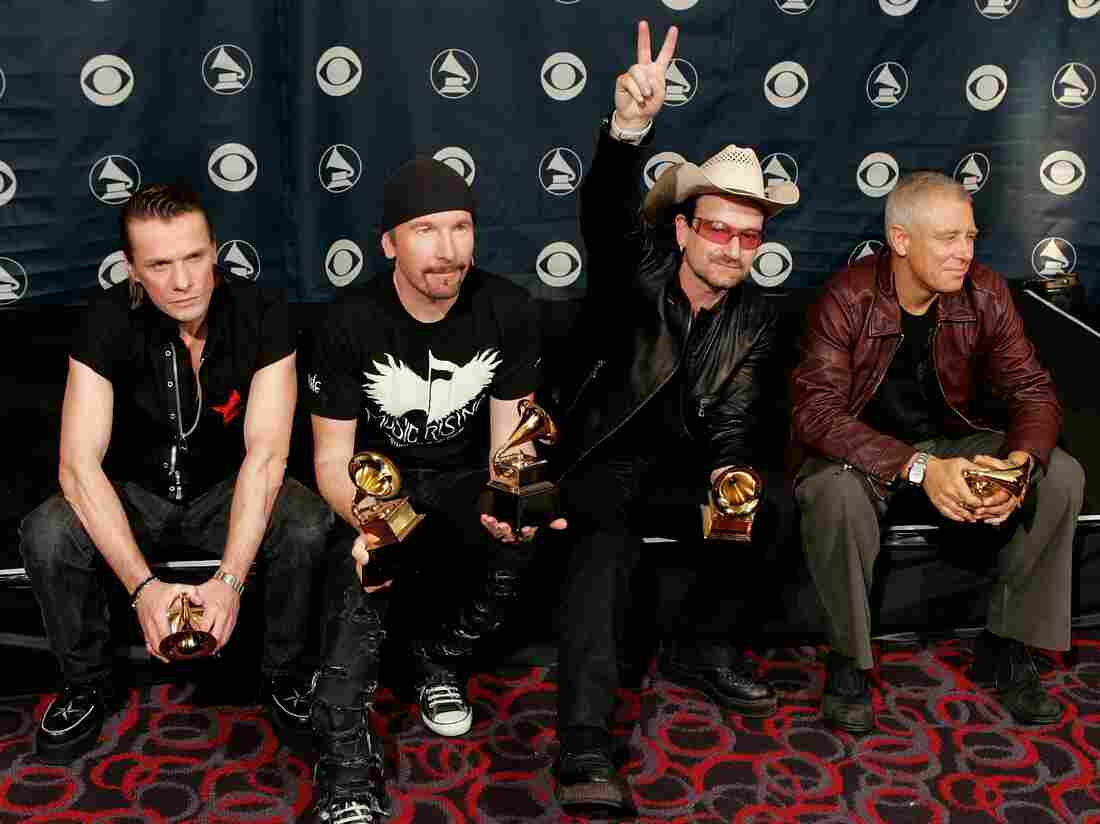 U2's Larry Mullens Jr. (from left), the Edge, Adam Clayton and Bono pose with their Album of the Year at the 48th Annual Grammy Awards.