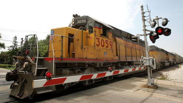 A Union Pacific freight train passes over a grade crossing in Elmhurst, Ill.